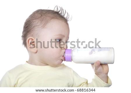 Baby is drinking milk - stock photo
