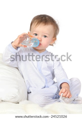 baby is drinking water from bottle - stock photo
