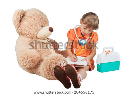 Baby is playing doctor, treats a bear, isolated on white background - stock photo