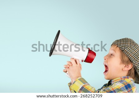 Baby. Kid shouting through vintage megaphone. Communication concept. Blue sky background as copy space for your text - stock photo