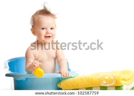 baby kid taking bath and playing - stock photo