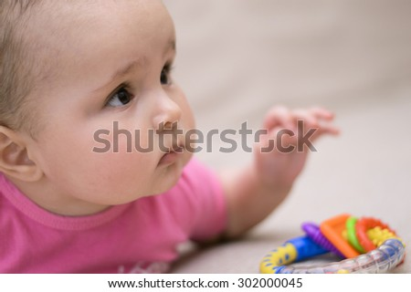 baby kid with toy rattle - stock photo