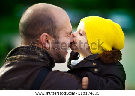 baby kisses  dad - stock photo