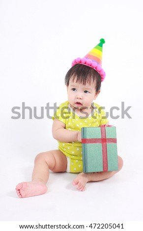 Baby laughing wearing party hat