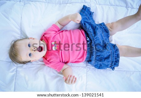 baby laying down - stock photo