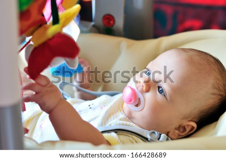 baby laying in bouncer chair - stock photo