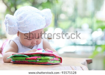 Baby laying in the garden see the baby book - stock photo