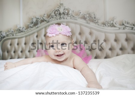 baby laying on the bed - stock photo