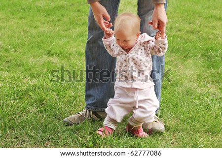 Baby learn walking in the park - stock photo