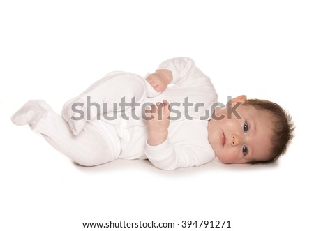 Baby learning to roll white background - stock photo