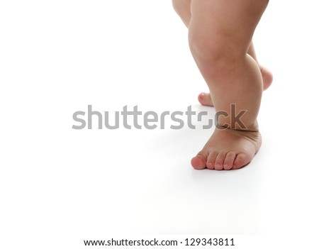 Baby legs isolated on white background - stock photo