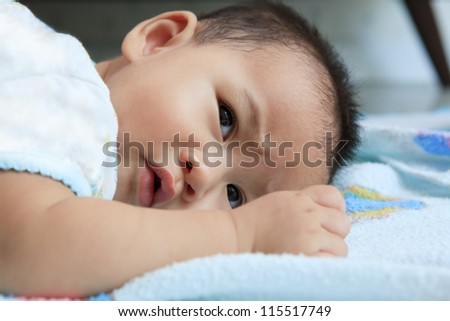 baby lied on bed and open eyes - stock photo