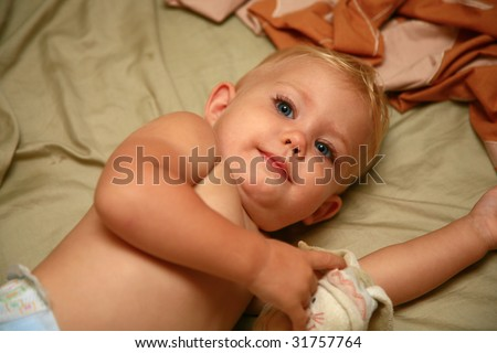 Baby ling on her side - stock photo