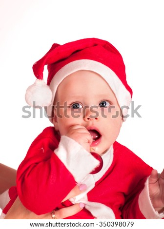 Baby little boy clothing for Santa hats holding Christmas ball. Isolated. - stock photo