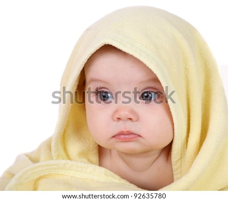 baby looking out from under blanket - stock photo