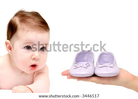 baby looking to girl shoes on white background - stock photo
