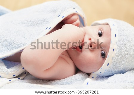 Baby lying in a towel - stock photo