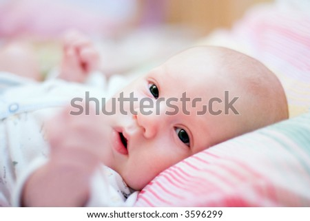 Baby lying on bed. Close up - stock photo