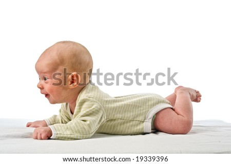 baby lying on stomach isolated on white