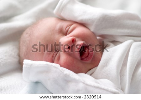 Baby making funny faces while napping - stock photo