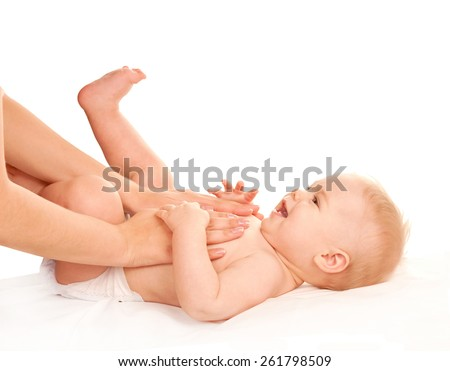 Baby massage. Mother massaging kid belly. Treatment of colic. Isolated on white background