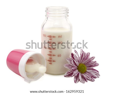 Baby milk bottle with flower isolated - stock photo
