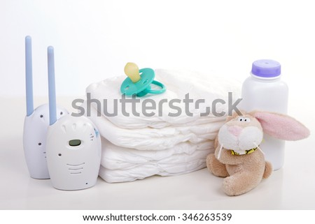 baby monitor, diapers. pacifier nipple. Toy hare - safety and care of the baby - stock photo