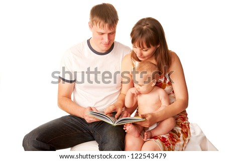 Baby, mother and father reading the book. Isolated on white background. - stock photo