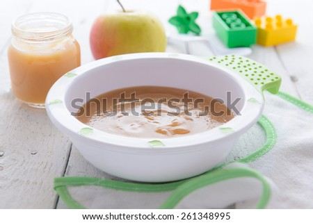 Baby nutrition - apple puree in bowl  - stock photo