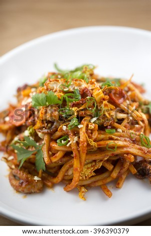 Baby octopus stir fry with udon noodles - stock photo