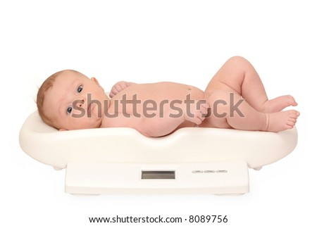 baby on  baby-scale - stock photo
