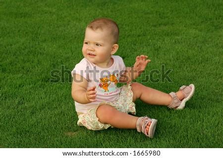Baby on grass - stock photo
