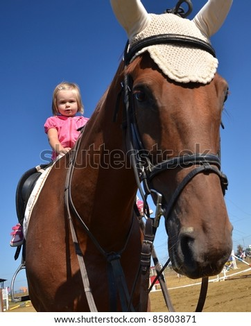 baby on horse - stock photo