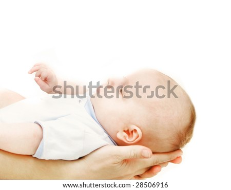 baby on parent's hands over white - stock photo