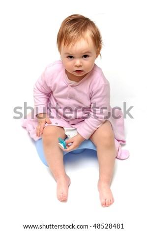 baby on potty - stock photo