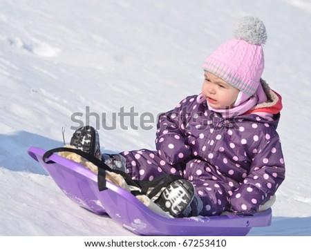 baby on sled - stock photo