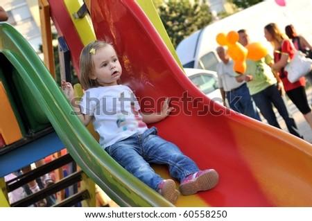 baby on slide playground area - stock photo