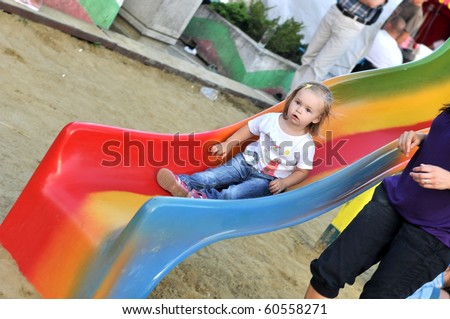 baby on slide playground area