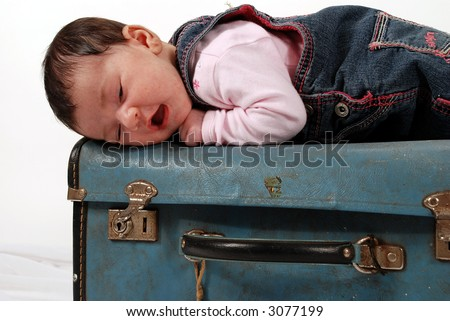 baby on suitcase - stock photo