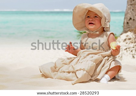 Baby on the beach - stock photo