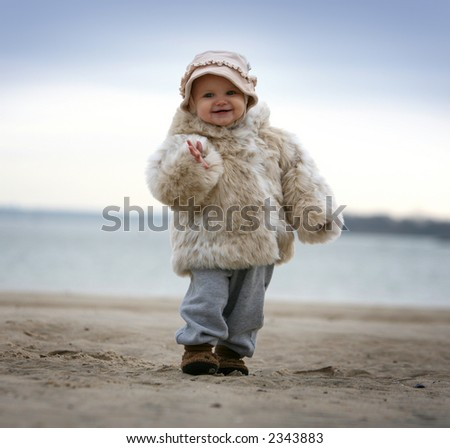 baby on the beach - winter - stock photo