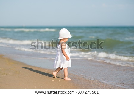 baby on the ocean beach - stock photo