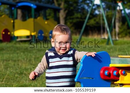 Baby on the playground - stock photo