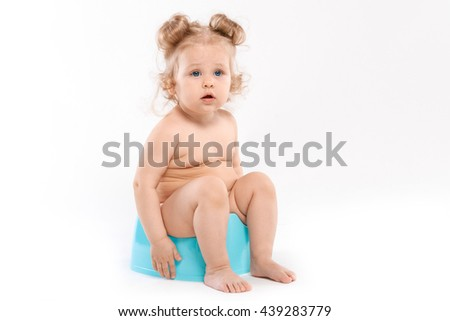baby on the pot on a white background - stock photo