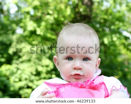 baby outdoor portrait with bright green background