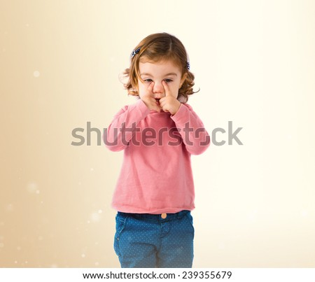 baby over ocher - stock photo
