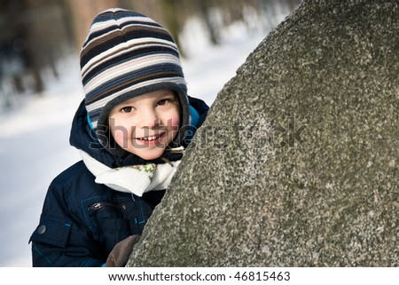 baby peep out of the stone - stock photo
