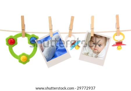 Baby photos hanging on the clothesline - stock photo