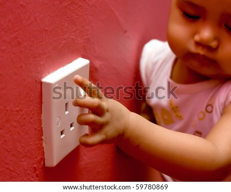 baby play electrical socket - stock photo