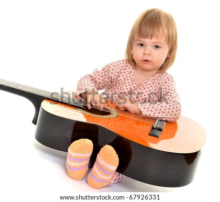 baby play on guitar isolated - stock photo